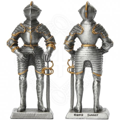 Tin knight statue in gilded armor with sword