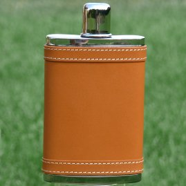Hip flask coated with leather