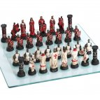Chess pieces crusaders with glass chess board